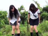 Asian teen pees in bushes
