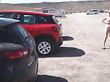 Naked pissing in beach car park