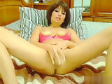 Brunette Bombonika plays with rubber penis