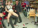 Mistress in leather dominates slave in public