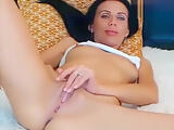 Brunette Rozeamore gently caresses her pussy
