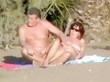 Lusty mature momma gets her shaved taco fingered on beach