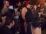 Gagged brunette tormented in public bar
